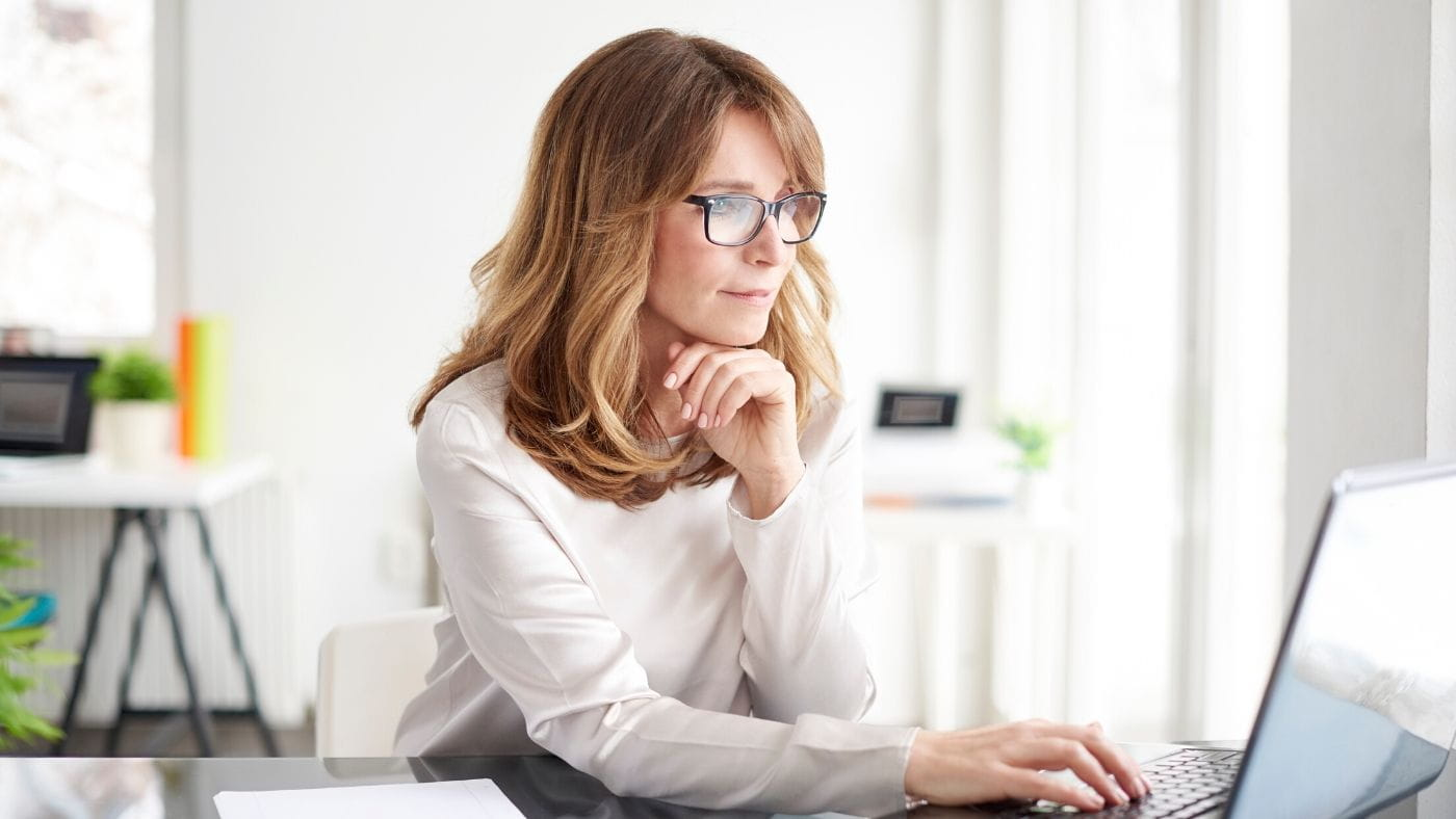 Female business woman looking at a laptop peacefully