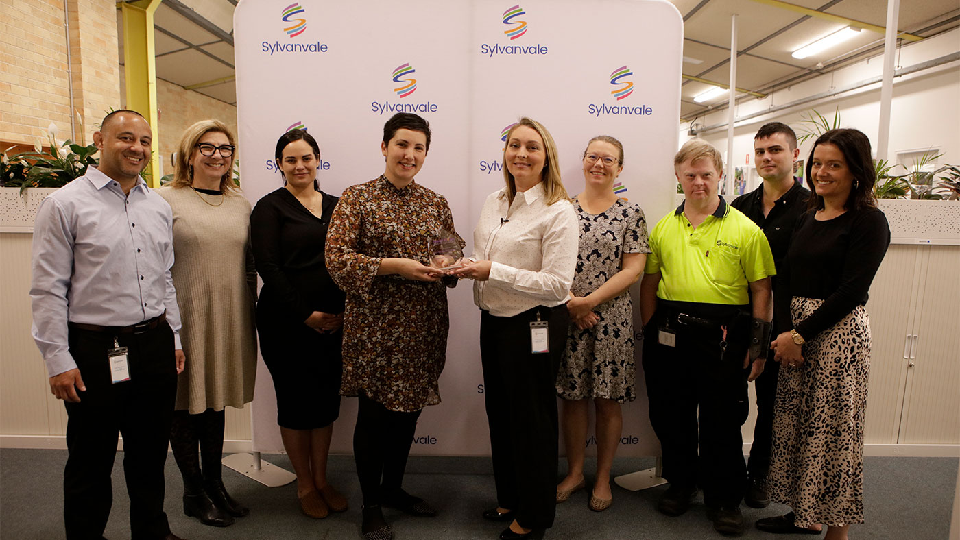Sylanvale employees being presented with the icare award for September at the Sylanvale office